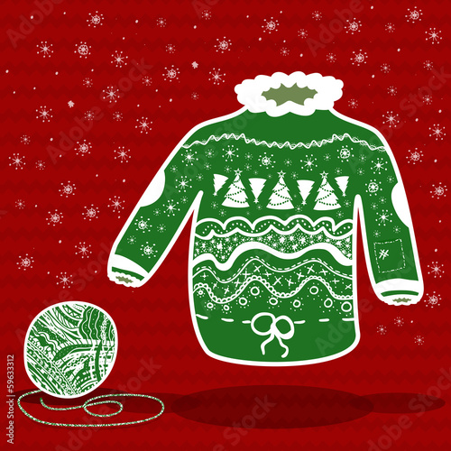 Green knitted christmas sweater and a ball of yarn