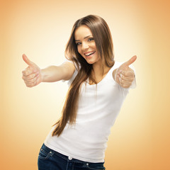 Happy smiling young woman with thumbs up gesture