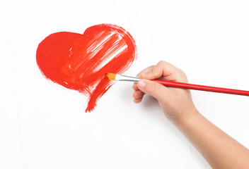 watercolor heart and child hand with paintbrush