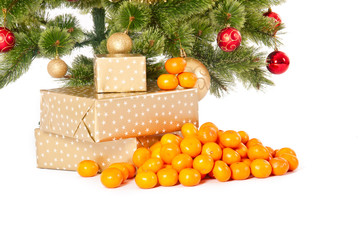 Christmas tree with gifts and mandarines