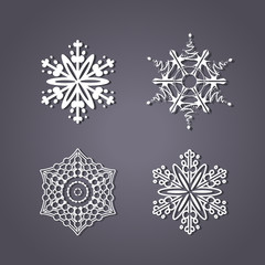 Vector set of white snowflakes on the grey background