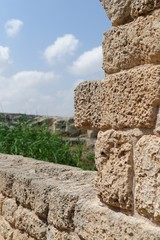 Ancient stone wall in Nahal Taninim archeological park in Israel