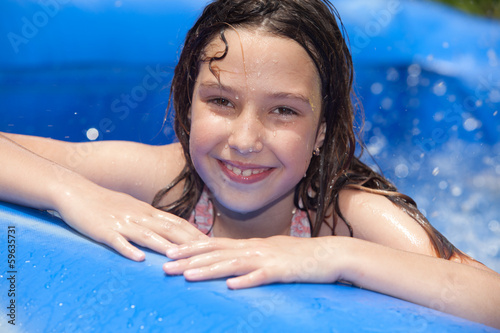 happy girl in the inflatable pool