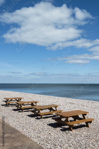 Picnic Tables on the Beach at Budleigh Salterton, Devon, UK.
