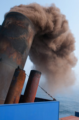 Smoke from a modern containership