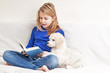 Girl reading a book little puppies