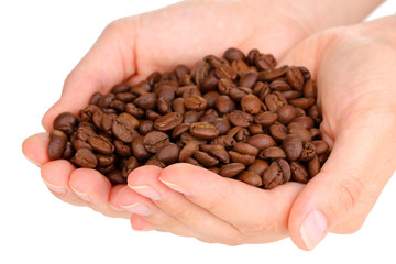 Coffee beans in hands close-up