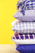Hill colorful pillows and plaid on yellow background
