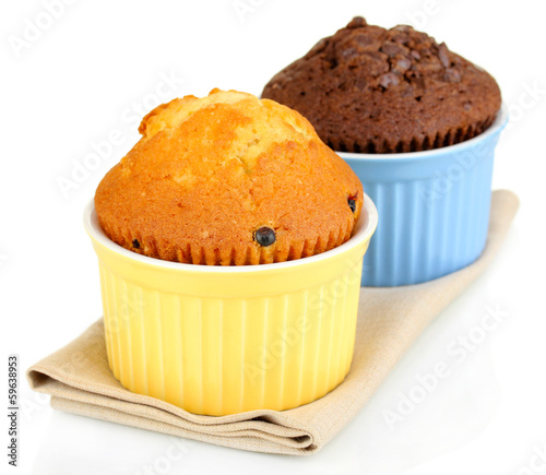 Cupcakes in bowls for baking isolated on white
