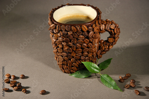 Cup of coffee beans, on grey background