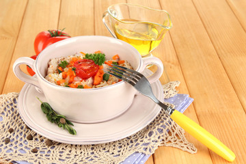 Delicious rice with vegetables and herbs in pot
