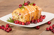 Cranberry walnut bread on a white plate
