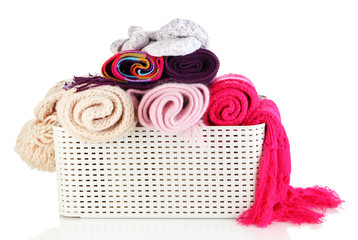 Plastic basket with scarves isolated on white