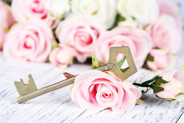 Key of happiness. Conceptual photo. Key with roses,