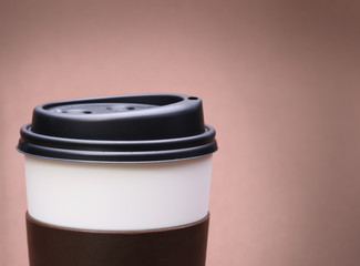 Paper Cup of Coffee on brown background. Takeaway or Disposable