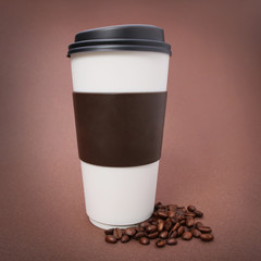 Paper Coffee cup with Coffee Beans on brown background. Takeaway