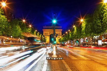 Evening on Champs-Elysees in front of Arc de Triomphe.Paris. Fra