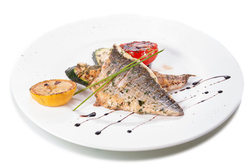Fried seabass with vegetable garnish