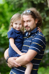 Young father and his daughter portrait