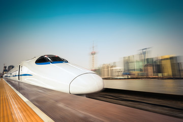 high speed train and modern urban background