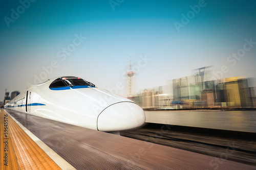 canvas print picture high speed train and modern urban background
