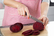 Housewife cutting beetroot