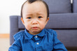 Asian baby boy feel sorrow