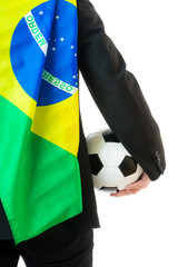 Businessman holding soccer ball and brazil flag