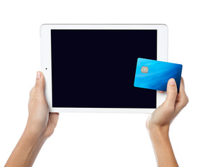 Human hands holding tablet pc and credit card