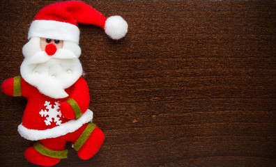 Santa Claus on a wood background