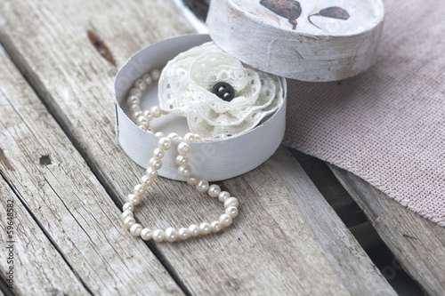 box with pearl necklace and brooch