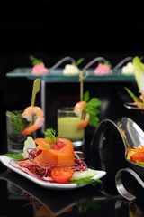 Smoked salmon with decoration and other dishes in background