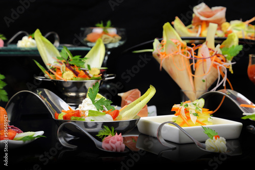 Various festive gourmet dishes on black background