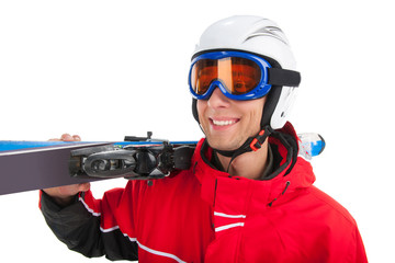Close up of active smiling skier in mask looking away.