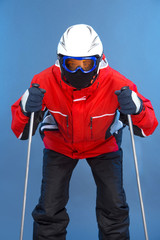 Sportive active skier skiing in white helmet and mask.