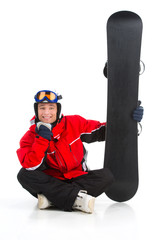 Funny male snowboarder sitting with snowboard.
