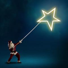Santa Claus pulls the shining star