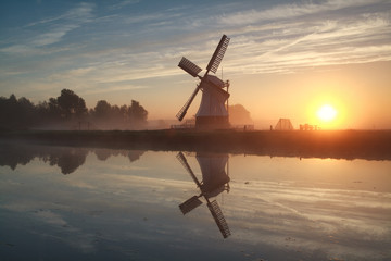 sunrise behind Dutch windmill
