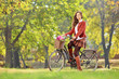 Young female on a bicycle in a park