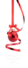 Red Christmas ball hanging with ribbon bow and curling paper