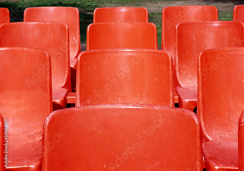 Red seats at the park