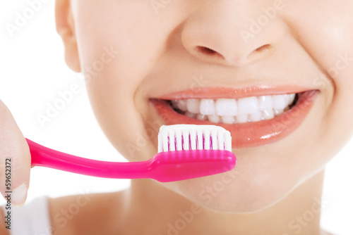 Young beautiful woman with toothbrush and paste.