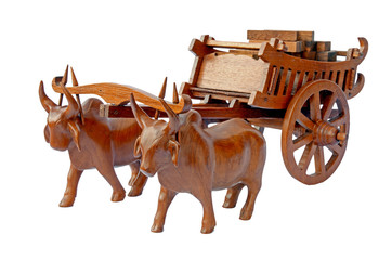 Teak wood craved cow and the carts.