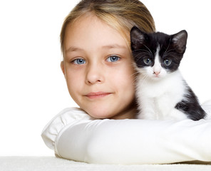 girl hugs a kitten