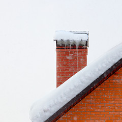Icicles on brick chimney