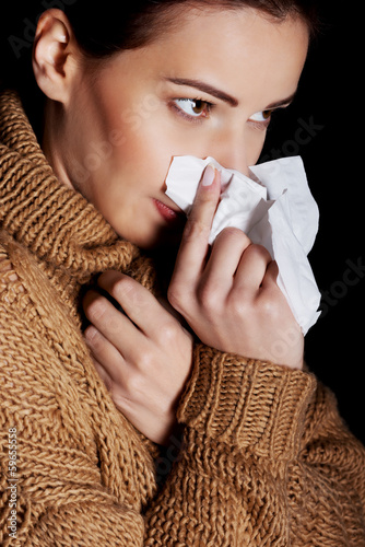 Young woman having depression with tissue.