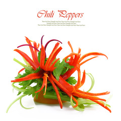 Decoration flowers from red chilly peppers isolated on white