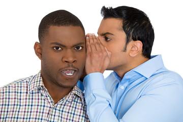 Man displeased surprised by gossip, office rumor