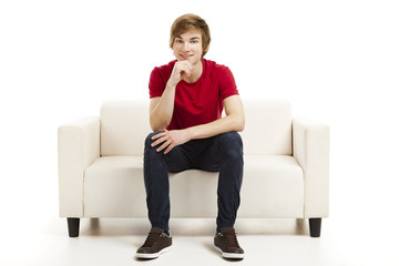 Young man sitting on the couch