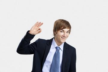 Businessman doing a Okay sign